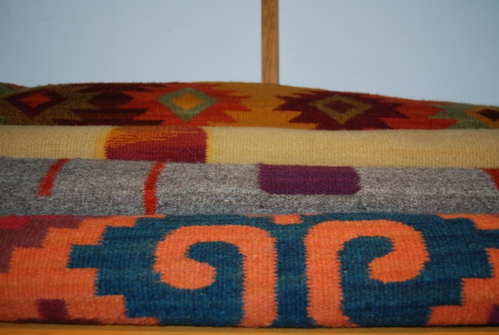 Master weaver from Teotitlan del Valle makes perfect curves with natural dyes